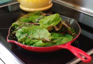 Wilting the swiss chard with champagne