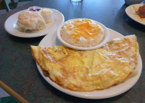 Hubby's Kitchen Sink omelette with cheese grits and housemade biscuit.  Of course I took bites.